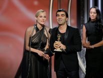 "Fatih Akin, director/producer, ""In the Fade"" accepts the award for Best Motion Picture Foreign Language with actress Diane Kruger"