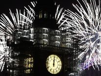 Fireworks explode over Big Ben and Parliament as thousands gather to ring in the near year on January 1, 2018 in London, England