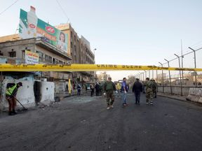 Officials close off the area following the attack in Baghdad