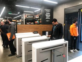 AMAZON.COM-STORE/SYSTEM IDENTIFIER:RTX4GUK1CODE:RC141E8E4BF0MEDIA DATE21 Jan. 2018PHOTOGRAPHER:Jeffrey DastinHEADLINE:A shopper scans a smartphone app associated with his Amazon account and credit card information to enter...SIZE:4032px × 2961px (~34 MB) 34.1 cm × 25.0 cm (300dpi)