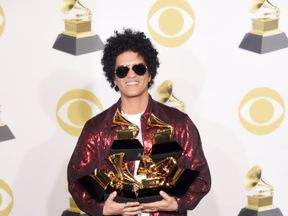 NEW YORK, NY - JANUARY 28: Recording artist Bruno Mars, winner of the Record of the Year award for '24K Magic,' Album Of The Year award for '24K Magic,' Song of the Year award for 'That's What I Like,' Best R&B Performance award for 'That's What I Like,' and Best R&B Album album for '24K Magic,' poses in the press room during the 60th Annual GRAMMY Awards at Madison Square Garden on January 28, 2018 in New York City. (Photo by Michael Loccisano/Getty Images for NARAS)