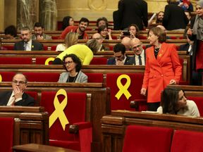 Deputies Jordi Turull, Marta Rovira and Carme Forcadell take their seats before the start of the first session of Catalan Parliament after regional elections