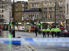Members of the emergency services outside Charing Cross railway station on the Strand