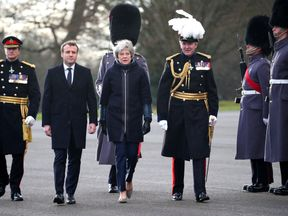 Emmanuel Macron and Theresa May arrive at Sandhurst Military Academy
