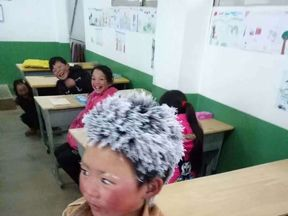 Wang Fuman had icicles in his hair and eyelashes after his long walk to school