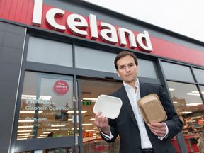 Richard Walker, with some non-plastic packaging, after they become the first major retailer to commit to eliminate plastic packaging
