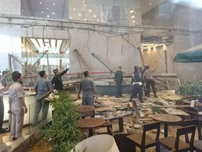 Officials surveyed the damage after the collapse of the mezzanine level