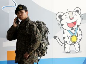 A South Korean soldier at the 2018 PyeongChang Winter Olympic and Paralympic Games PR booth