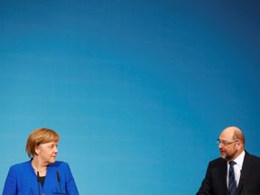 Acting German Chancellor Angela Merkel and Social Democratic Party (SPD) leader Martin Schulz attend a news conference after exploratory talks about forming a new coalition government at the SPD headquarters in Berlin, Germany, January 12, 2018. REUTERS/Hannibal Hanschke
