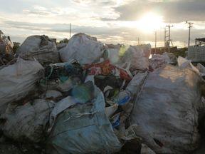 Plastic scrap sits on a yard in Thailand