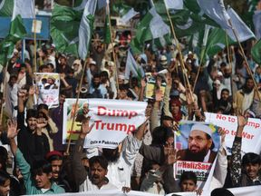 Activists shouting anti-US slogans at a protest in Karachi