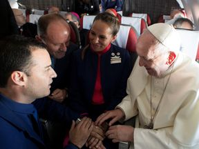 Pope Francis marries crew members Paula Podest (C) and Carlos Ciufffardi