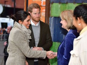 Prince Harry and Meghan Markle during a visit to youth-orientated radio station, Reprezent FM, in Brixton, south London