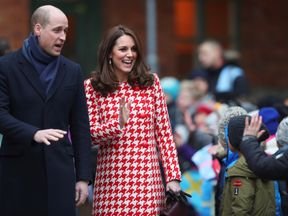 Prince William and Kate wave to excited youngsters in the Swedish capital