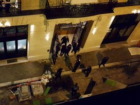 Police at the Ritz Hotel in Paris after it was raided and robbed by thieves