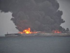 Smoke and fire is seen from Panama-registered tanker SANCHI carrying Iranian oil after it collided with a Chinese freight ship in the East China Sea, in this still image taken from a January 7, 2018 video