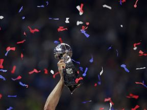 The Vince Lombardi trophy is raised to the sky during Super Bowl LI