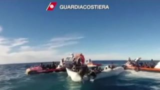 Footage shows dramatic rescue of migrants off Libyan coast.