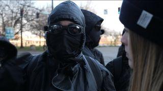 Antifa members dress all in black