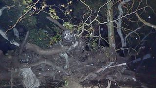 An overturned car is entangled in debris after a mudslide in Montecito, California