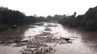 Debris floats in flooded waters on the freeway after a mudslide in Montecito, California