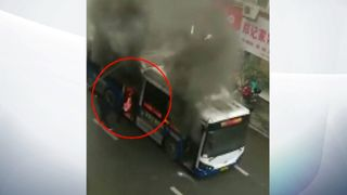 The man is pulled from the burning bus