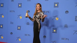 "Allison Janney poses with the award for Best Performance by an Actress in a Supporting Role in any Motion Picture for ""I, Tonya"""