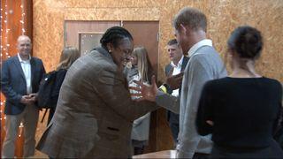 Prince Harry tries a Brixton handshake