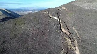 A drone reveals a major crack at Rattlesnake Ridge, Washington, which has seen people evacuated from the area