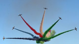 The United Arab Emirates' Al-Fursan (The Knights) National Aerobatic Team perform during the 4th Saudi Aviation Exhibition at the Thumamah Airport