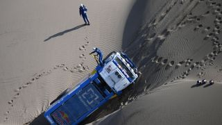 Eduard Nikolaev and copilot Evgeny Yakovlev of Russia work on their Kamaz truck during the Peru-Bolivia-Argentina Dakar rally