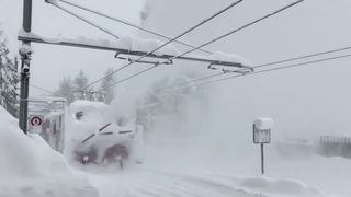 A train clears snow from a railway in Zermatt resort, Switzerland