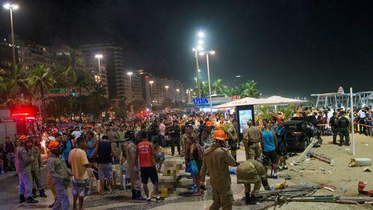 Paramedics help the injured after a vehicle ran over people at Copacabana beach in Rio de Janeiro, Brazil