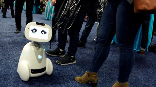 A Buddy robot by Blue Frog roams the floor during the opening event at CES