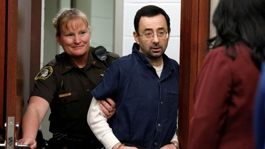 Larry Nassar is escorted into the courtroom during his sentencing hearing in Lansing, Michigan
