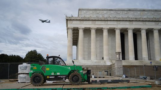 A forklift truck sits idle in front of the Lincoln Memorial during the shutdown