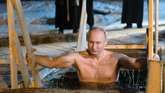 Russian President Vladimir Putin takes a dip in the water during Orthodox Epiphany celebrations at lake Seliger, Tver region, Russia