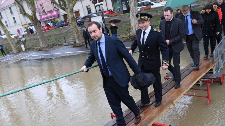 Ecology minister Sebastien Lecornu (l) visited Conflans-Sainte-Honorine outside Paris