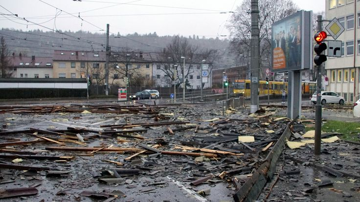 Debris of a roof lay in a street in Stuttgart