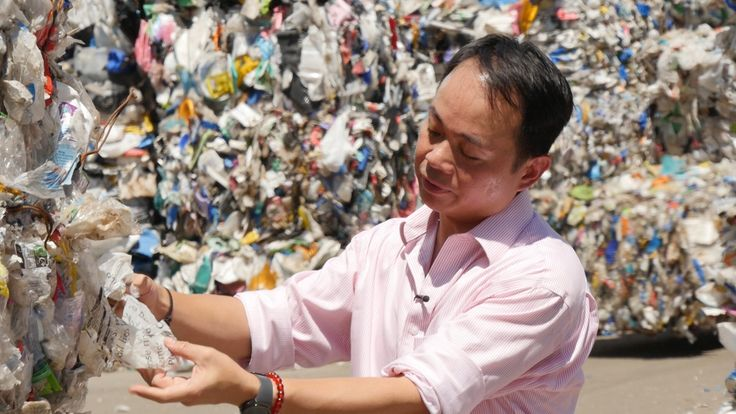 Plastics trader Tony Wong inspects plastic recycling that originally came from Chelmsford Council