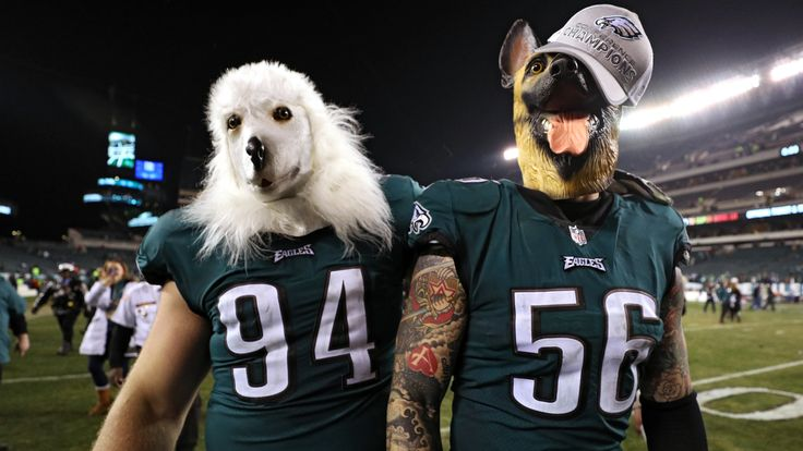 Beau Allen #94 and Chris Long #56 of the Philadelphia Eagles celebrates their teams win while wearing a dog masks