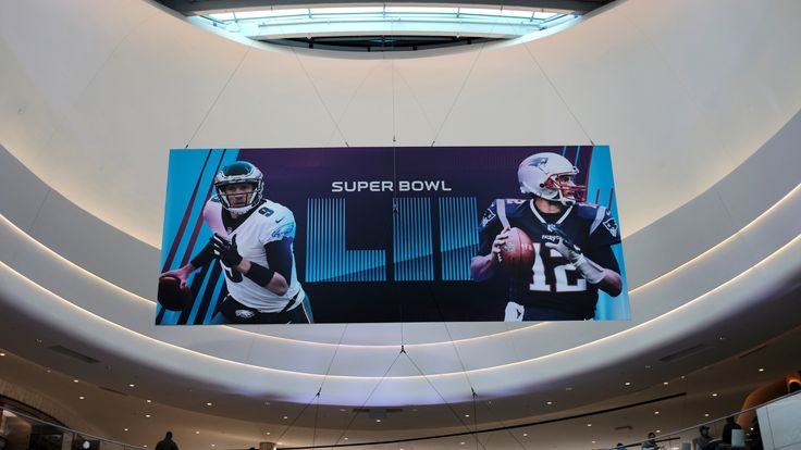 A Super Bowl promotional banner showing Philadelphia Eagles quarterback Nick Foles and New England Patriots quarterback Tom Brady in an atrium at the Mall of America