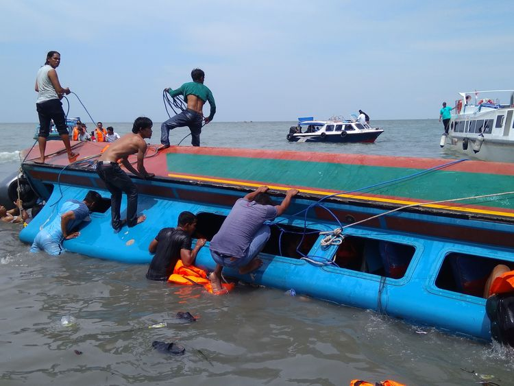 Rescue workers at the site of the accident in July last year