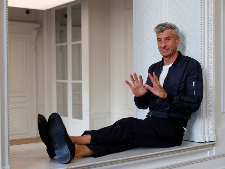 The artist of the piece, Italian Maurizio Cattelan