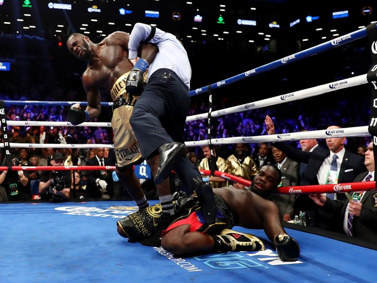 NEW YORK, NY - NOVEMBER 04: Deontay Wilder knocks out Bermane Stiverne in the first round as referee Arthur Mercante Jr. steps in during their rematch for