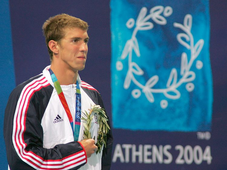 Michael Phelps wins gold at his first Olympic Games in Athens in 2004