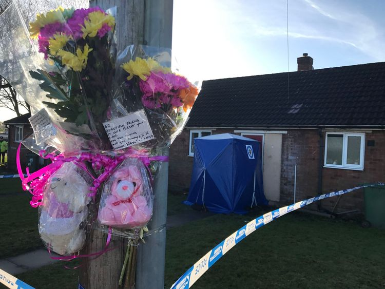 Flowers and teddy bears in remembrance of Mylee Billingham tied to a post outside the property in Brownhills, near Walsall, where the eight-year-old was found with fatal knife wounds on Saturday