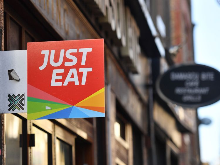 A sign for Just Eat, a food delivery service can be seen above a grill in London on Dec 18, 2017...Just Eat has been welcomed on Dec 18, 2017 into UKs FTSE 100 index of the countrys largest publicly listed companies.  / AFP PHOTO / BEN STANSALL        (Photo credit should review BEN STANSALL/AFP/Getty Images)