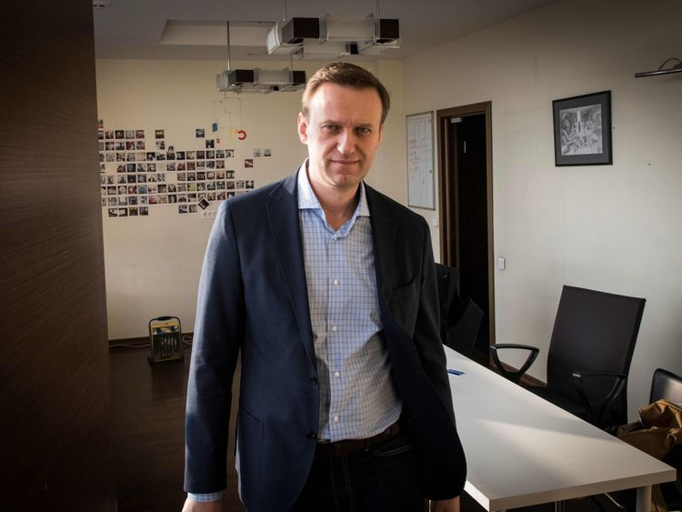 Russian opposition leader Alexei Navalny poses during an interview with AFP at the office of his Anti-corruption Foundation (FBK) in Moscow on January 16, 2018