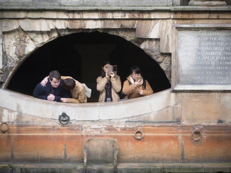 Tourists take snaps of Bath's historic Roman Baths